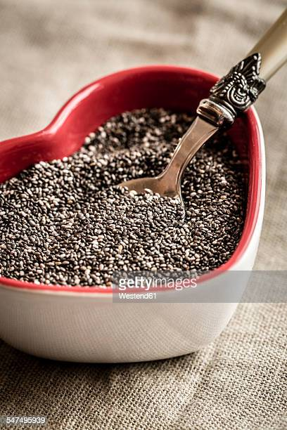 Heart-shaped bowl of chia seeds