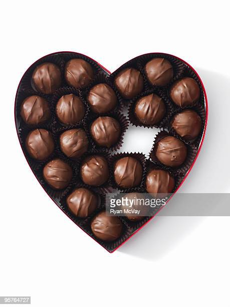 heart-shaped box full of chocolates - box of chocolate stock pictures, royalty-free photos & images