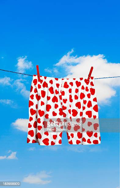 heart-shaped boxer shorts on washing line - shorts stock pictures, royalty-free photos & images