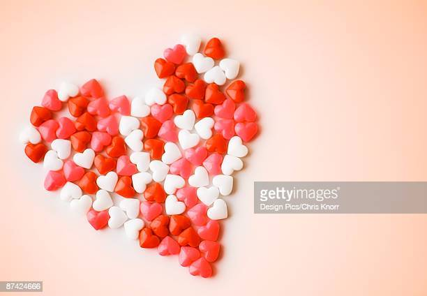 heart-shaped candies forming heart shape - candy heart stock pictures, royalty-free photos & images