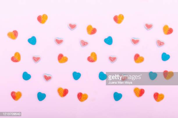 heart-shaped candies on pink background - sweet food stock pictures, royalty-free photos & images