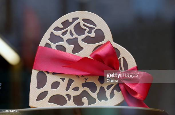 A heartshaped chocolate box is displayed in a showcase on Valentine's Day on February 14 2017 in Paris France Saint Valentine's Day is recognized as...