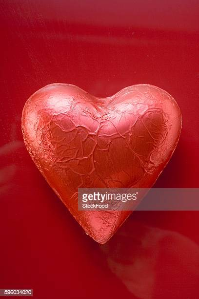Heart-shaped chocolate in red foil