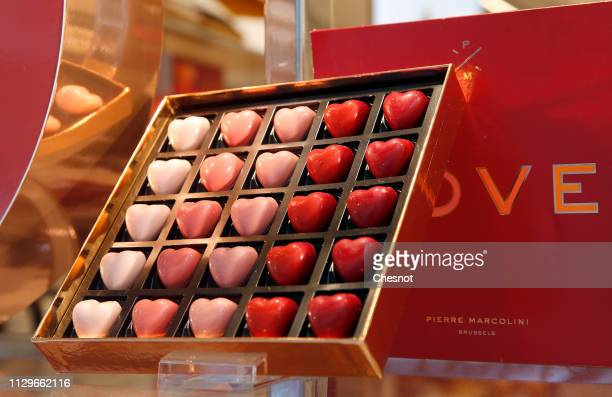 Heart-shaped chocolates are seen in the window of a pastry shop on Valentine's Day on February 14, 2019 in Paris, France. Valentine's Day is known as...