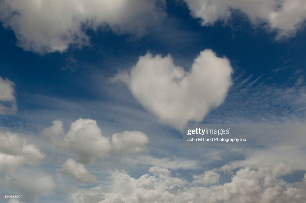 Heart-shaped cloud in sky : Stock Photo