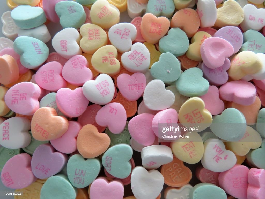 Heart-shaped conversation candies, background, copy space : Stock Photo