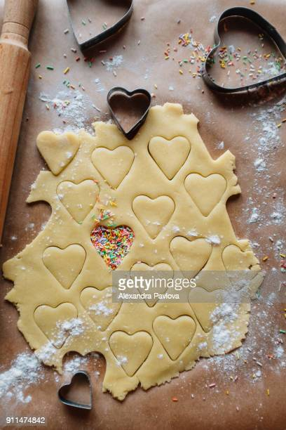 Heart-shaped cookies in the making
