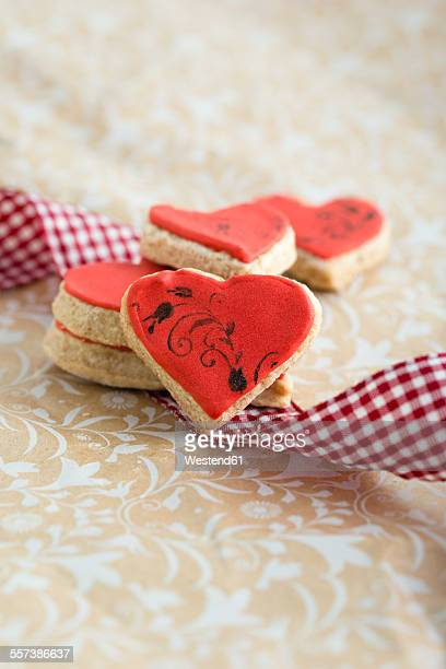 Heart-shaped cookies with stamp motife, ribbon