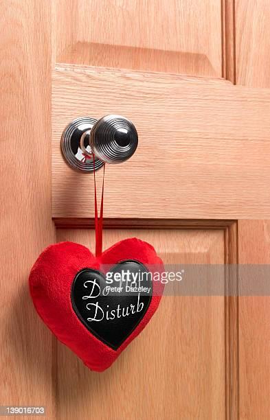 Heart-shaped 'do not disturb' sign