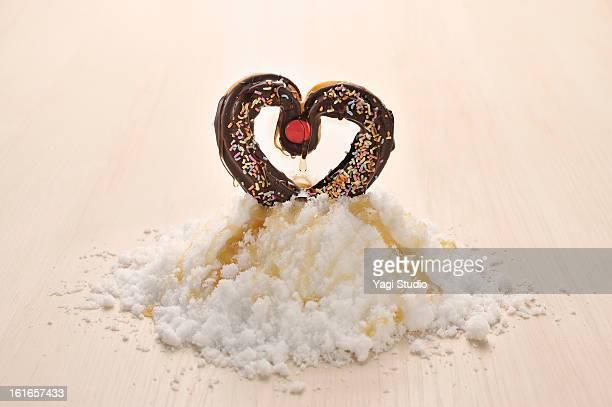 Heart-shaped donuts and sugar