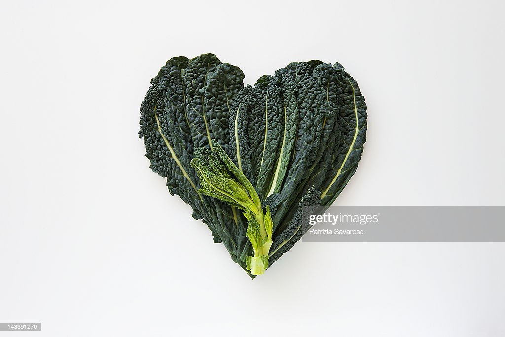 Heart-shaped formed by fresh Black Kale : Stock Photo