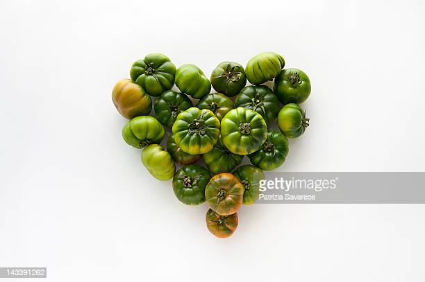 Heart-shaped formed by fresh Green Tomatoes