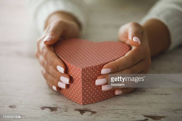 heart-shaped gift box for special ocassion - souvenir stock pictures, royalty-free photos & images