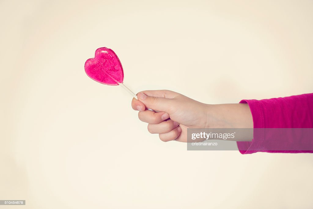 Heart-shaped lollipop : Stock Photo
