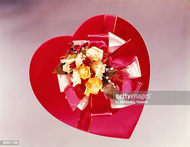 Heartshaped red satin covered box of chocolates