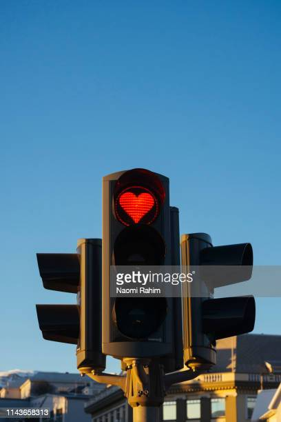 heart-shaped red stop traffic light in akureyri, iceland - walk don't walk signal stock pictures, royalty-free photos & images