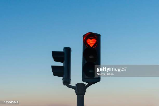 heart-shaped red stop traffic light in akureyri, iceland - red light stock pictures, royalty-free photos & images