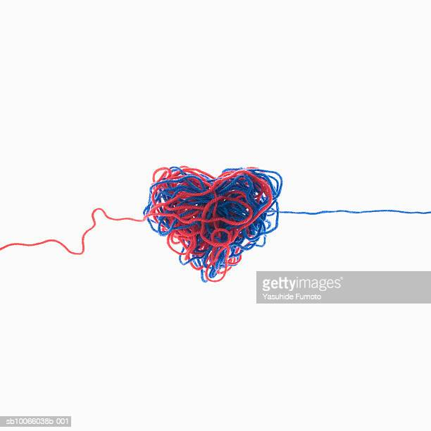 Heart-shaped tangle of red and blue knitting yarn