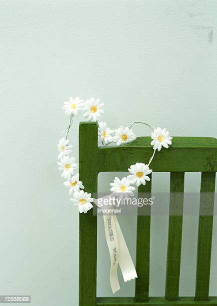 A heart-shaped wreath and chair