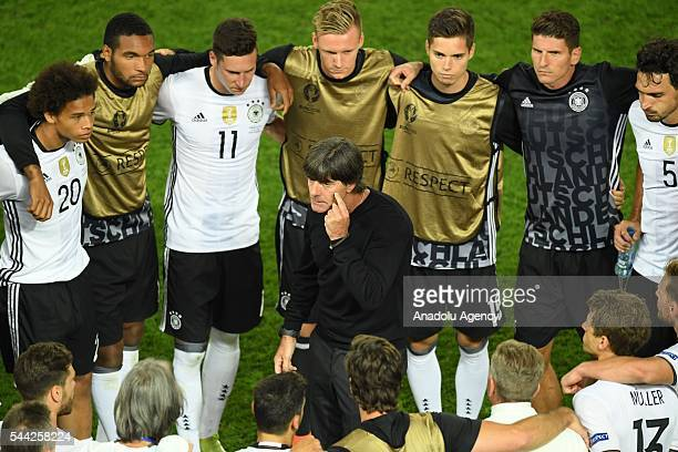 Heas coach Joachim Low of Germany speaks to players during the UEFA Euro 2016 quarter final match between Germany and Italy at Stade de Bordeaux in...