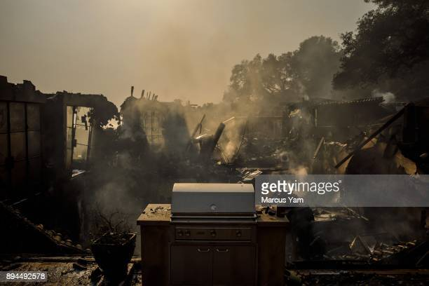 Heat and smoke rises from the rubble of a home that was destroyed by the Thomas Fire on December 17 2017 in Montecito California