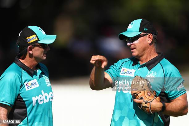 Heat coach Peter McGiffin and assistant coach Scott Prestwidge talk during the Women's Big Bash League match between the Brisbane Heat and the Perth...