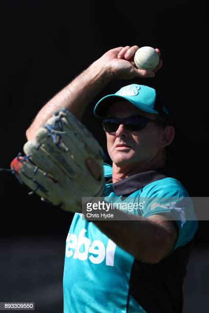 Heat coach Peter McGiffin fields during the Women's Big Bash League match between the Brisbane Heat and the Perth Scorchers at Allan Border Field on...