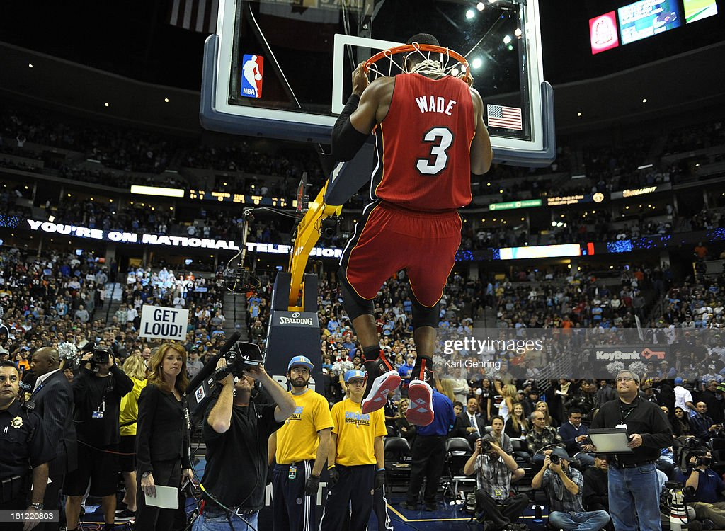 Heat guard Dwayne Wade did pull-ups on the rim before the game Friday night. The Denver Nuggets hosted the Miami Heat Friday night, January 13, 2012 at the Pepsi Center. Karl Gehring/The Denver Post : News Photo