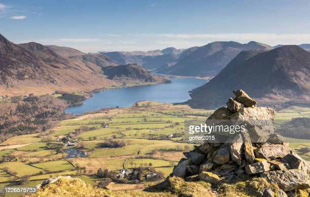 heat haze over crummock water - low fell - lake district - england - national park stock pictures, royalty-free photos & images
