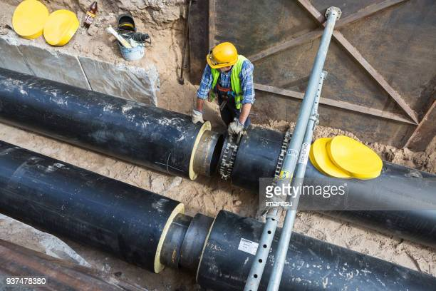 heat pipe replacement works - sewer stock pictures, royalty-free photos & images
