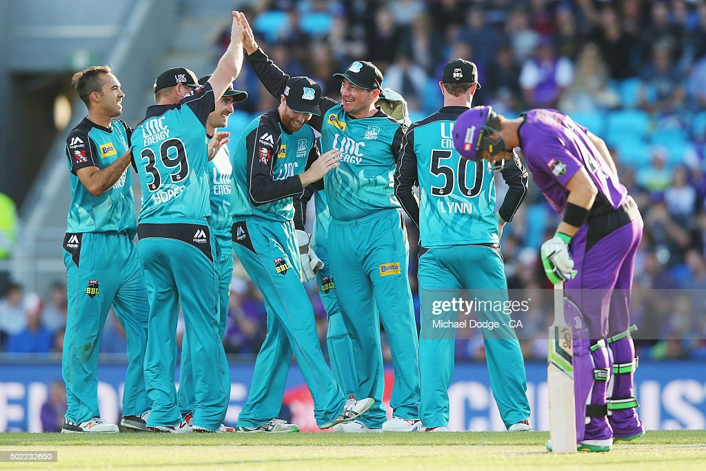 Heat players celebrate running out Ben Dunk of the Hurricanes during the Big Bash League match between Hobart Hurricanes and Brisbane Heat at Blundstone Arena on December 22, 2015 in Hobart, Australia.