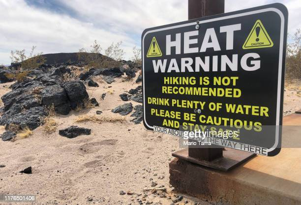 A heat warning is posted on a hiking trail in the Mojave desert on September 22 2019 in Amboy California California's Fourth Climate Change...