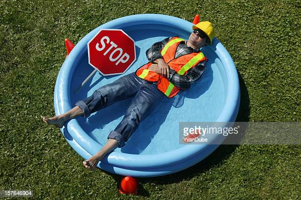 heat wave construction worker in swimming pool