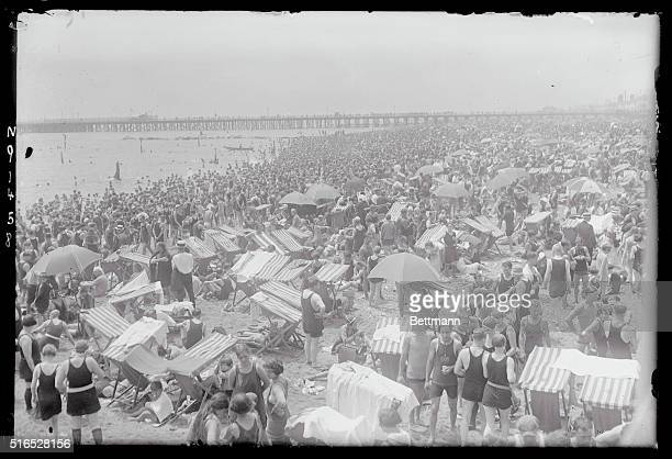 Heat Wave Piles Up New Crowd Record as 750000 Seek Relief at Coney Island Brooklyn New York Coney Island came into its won as record crowd of 750000...