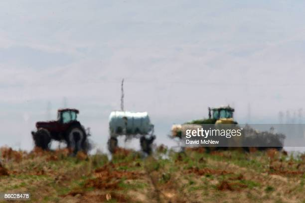 Heat waves distort the shapes of farm equipment in a field on April 18 2009 near Firebaugh California Central Valley farmers and farm workers are...
