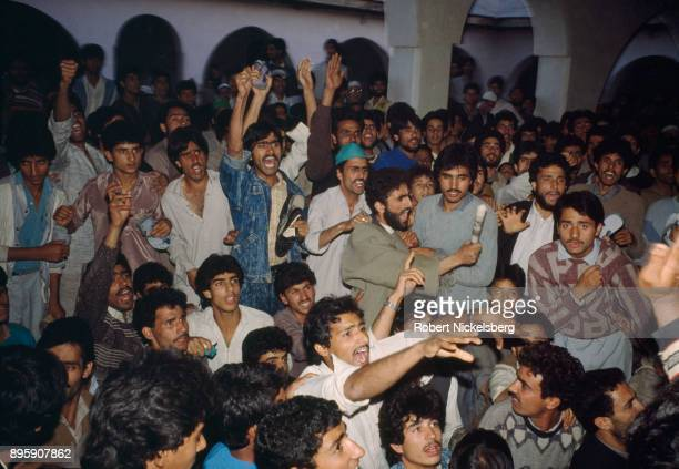 A heated discussion among moderate and militant Kashmiri separatists takes place at a mosque October 8 1989 in Anantnag India Following the allegedly...