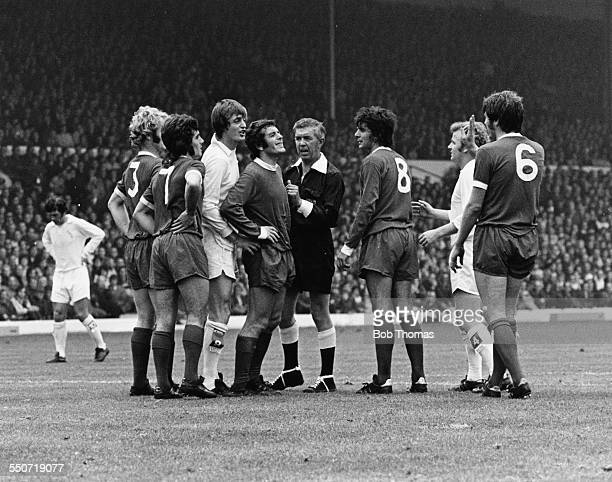 A heated exchange between Leeds United and Liverpool football players and the referee including Allan Clarke and Emlyn Hughes at Elland Road...