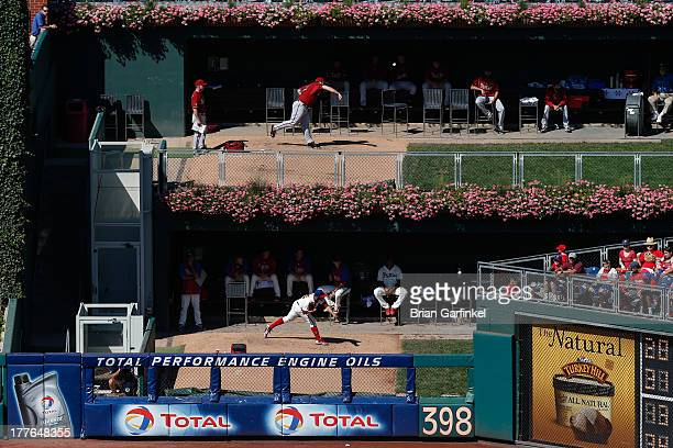 Heath Bell of the Arizona Diamondbacks and Cesar Jimenez of the Philadelphia Phillies warm up in the bull pen in the sixth inning of the game at...