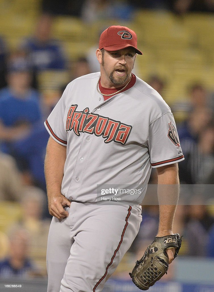 Heath Bell #21 of the Arizona Diamondbacks reacts to the third Los Angeles Dodgers out for a 5-3 win during the ninth inning at Dodger Stadium on May 7, 2013 in Los Angeles, California.