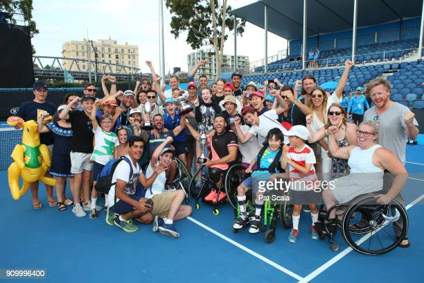Heath Davidson of Australia and Dylan Alcott of Australia are surrounded by fans as they hold up the trophy after winning the Quad Wheelchair Doubles...