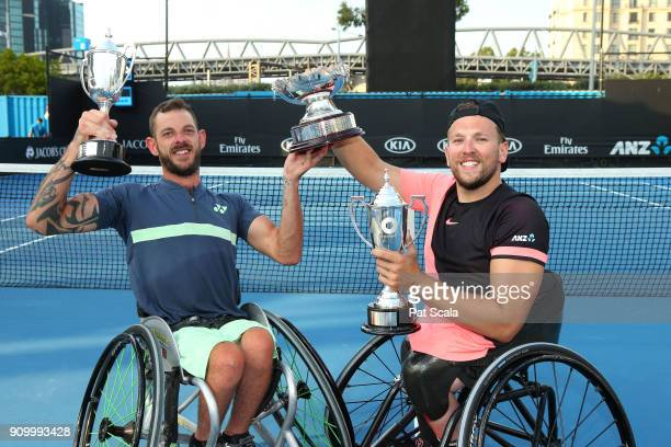 Heath Davidson of Australia and Dylan Alcott of Australia hold up the trophy after winning the Quad Wheelchair Doubles Final against Andy Lapthorne...