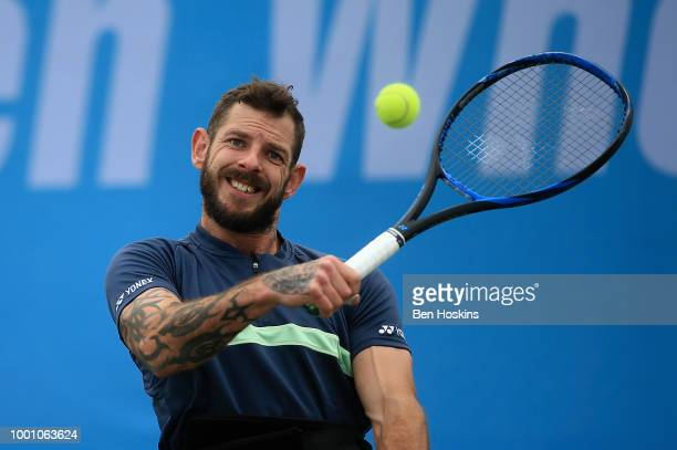 Heath Davidson of Australia plays a backhand during his match against Robert Shaw of Canada on day two of The British Open Wheelchair Tennis...