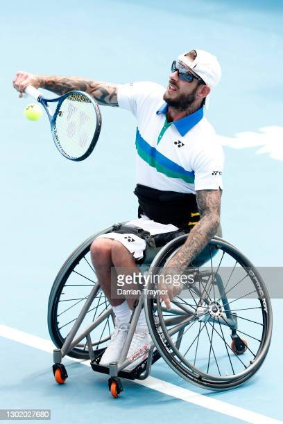 Heath Davidson of Australia plays a backhand in his Quad Wheelchair Singles Quarterfinals against Dylan Alcott of Australia during day seven of the...