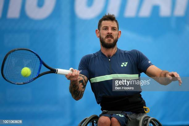 Heath Davidson of Australia plays a forehand during his match against Robert Shaw of Canada on day two of The British Open Wheelchair Tennis...