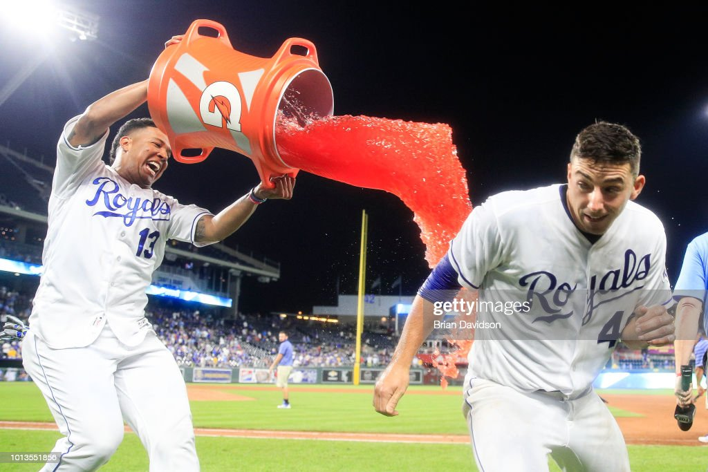 Heath Fillmyer #49 of the Kansas City Royals jumps out of the way of Salvador Perez's attempt to dump Gatorade on him after the game against the Chicago Cubs at Kauffman Stadium on August 8, 2018 in Kansas City, Missouri.