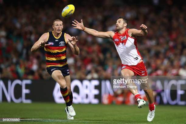 Heath Grundy of the Swans contests the ball Sam Jacobs of the Crows during the round five AFL match between the Sydney Swans and the Adelaide Crows...