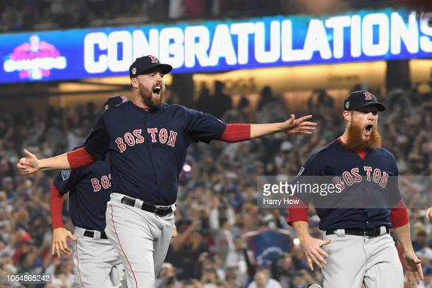Heath Hembree and Craig Kimbrel of the Boston Red Sox celebrate defeating the Los Angeles Dodgers 51 in Game Five of the 2018 World Series at Dodger...
