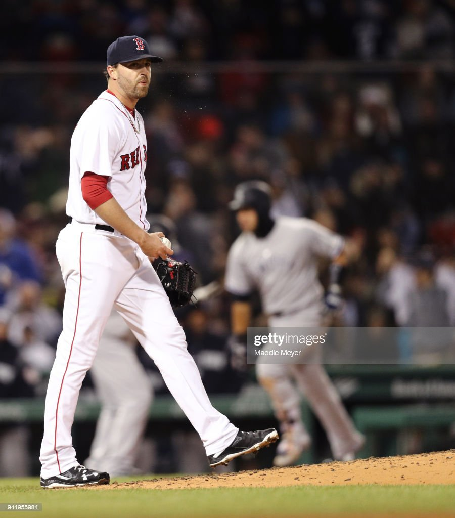 Heath Hembree #37 of the Boston Red Sox reacts as Gary Sanchez #24 of the New York Yankees rounds the bases after hitting a two run home run during the fourth inning at Fenway Park on April 11, 2018 in Boston, Massachusetts.