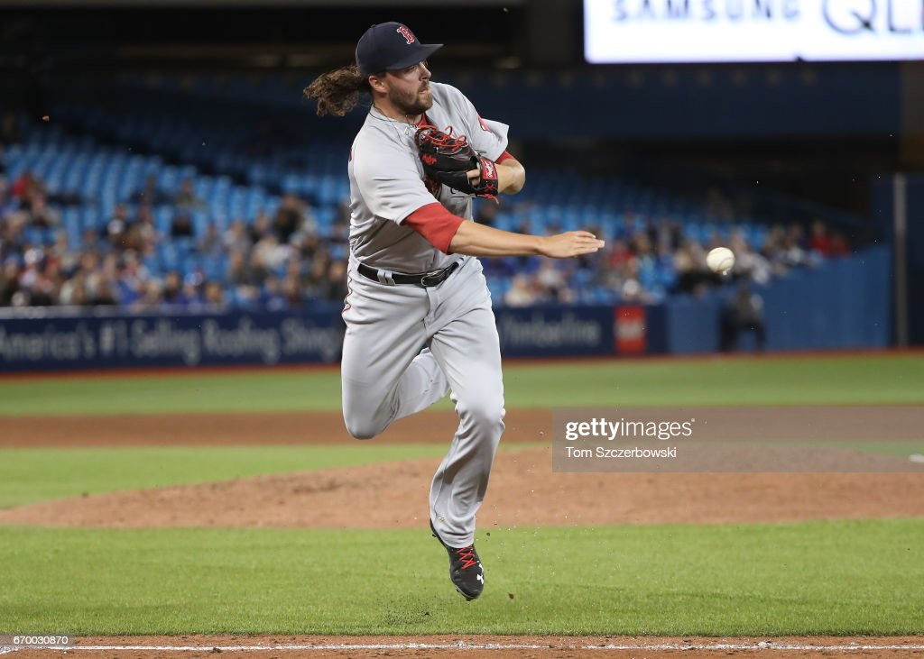 Heath Hembree #37 of the Boston Red Sox throws out Darwin Barney #18 of the Toronto Blue Jays after fielding a soft grounder up the first base line in the seventh inning during MLB game action at Rogers Centre on April 18, 2017 in Toronto, Canada.