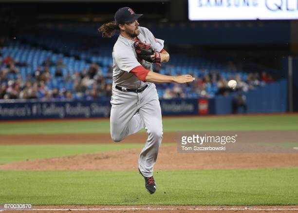 Heath Hembree of the Boston Red Sox throws out Darwin Barney of the Toronto Blue Jays after fielding a soft grounder up the first base line in the...